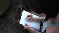 Girl artist drawing a portrait with a pencil Stock Footage