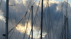 Boat masts with windspeed indicators and moving clouds. Stock Footage