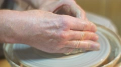 Male Hands Are Molding a Pot by Thumbs Man Potter is Making a Clay Pot Working Stock Footage