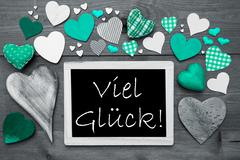 Gray Chalkbord, Green Hearts, Viel Glueck Means Good Luck - stock photo