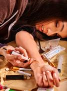 Female drug addict with   syringe Stock Photos