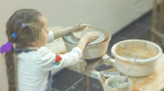 Girl is Molding a Clay Using a Big Spatula Working on a Pottery Wheel Little Stock Footage