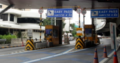 Traffic at Highway Toll Booth - stock footage