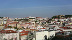 Lisbon orange roof white building city during sunset, pan left, Portugal Stock Footage