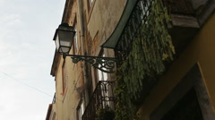 Old rustic beautiful building with street lantern light, Lisbon, Portugal Stock Footage