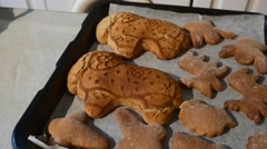 Female Hand Has Placed a Ram Shaped Cookie Angel-Shaped Cookies Baked Biscuits Stock Footage