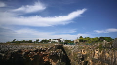 Tilt down to Boca do Inferno, Devils Mouth, sunny day, Portugal Stock Footage