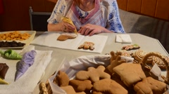 Woman is Putting a Yellow Mastique Heart-Shaped Christmas Cookies Biscuits Stock Footage
