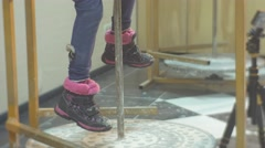 Little Girl's Feet Don's Reach a Pottery Wheel Kid is Molding a Clay Circle - stock footage