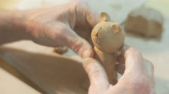 Male Hands Are Sculpting a Clay Cat Statuette Holding the Figurine Put it to a Stock Footage