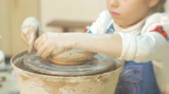 Kid is Molding an Edges Of a Vase Tears Off Piece of Clay Little Blonde Girl is Stock Footage