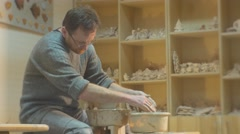Man is Molding a Clay Pot by Hands Then Takes Spatula Continue to Mold His Stock Footage