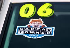 Stock Photo of CARFAX Logo and Emblem on Auto Windshield