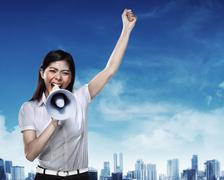 Business woman using megaphone Stock Photos