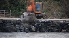 Time lapse of an excavator breaking and drilling the concrete road Stock Footage