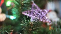 Christmas tree ornament - Purple star rack focus on snowman Stock Footage