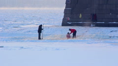 People bathe in the river Neva in winter. St. Petersburg. Russia Stock Footage