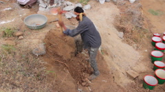 Indian worker digging with a pick. 2015.Udaipur. Rajasthan Stock Footage