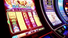 Close up woman playing slot machine inside Hard Rock Casino - stock footage