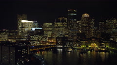 Downtown Boston at night from the Charles River. Shot in 2011. - stock footage