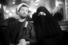 Portrait of islamic couple, smoking shisha. - stock photo