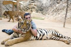 Stock Photo of People with tiger temple, Bangkok, Thailand