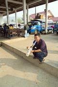 PONGSALI, LAOS - APRIL 2014: local man smoking bong . - stock photo