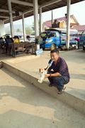 Stock Photo of PONGSALI, LAOS - APRIL 2014: local man smoking bong .