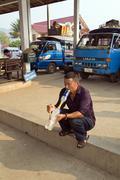 PONGSALI, LAOS - APRIL 2014: local man smoking bong . Stock Photos