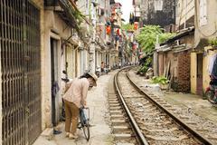 Stock Photo of HANOI, VIETNAM - MAY 2014: train passing through slums