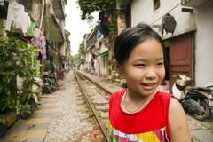 Stock Photo of HANOI, VIETNAM - MAY 2014: kids at railway slums.