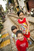 HANOI, VIETNAM - MAY 2014: kids at railway slums. Stock Photos