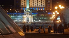 People Spend the Time at Independence Monument Kiev Brightly Illuminated - stock footage