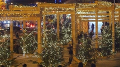 Crowd People Families at the Decorated Firs Christmas Eve New Year's Evening on - stock footage