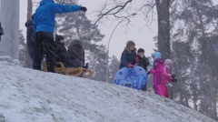 Parents Pushes a Sleighs Bucha Ukraine Children Riding on a Sleigh Downhill - stock footage