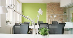 Empty office shared workspace bright natural light in modern business - stock footage