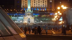 People Families at Independence Monument in Kiev Brightly Illuminated - stock footage