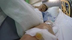 Woman Lying In Hospital Bed with Drop Bottle and Suffering. 2.7K Stock Footage