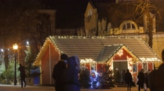People Enter to a Shop at Christmas Fair House Illuminated With Christmas - stock footage