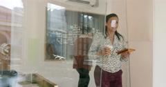 Steadicam follow shot of business woman walking through creative modern office Stock Footage