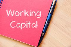 Working capital write on notebook Stock Photos