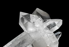 Transparent rock crystals on black - stock photo