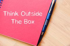 Think outside the box write on notebook Stock Photos