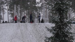 Parents and Kids Wintry Park Bucha Ukraine Child is Smiling Riding on a Sleigh - stock footage