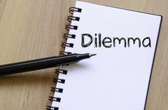 Dilemma write on notebook Stock Photos