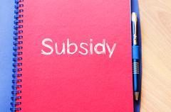 Subsidy write on notebook Stock Photos