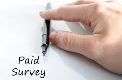 Paid survey text concept Stock Photos