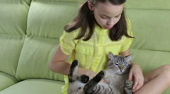 Little girl communicates with her beloved cat - stock footage