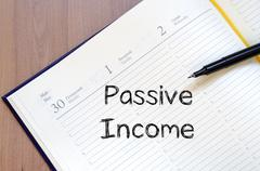 Passive income write on notebook - stock photo