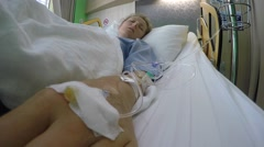 Female Patient Lying in Bed in Hospital with Drop Counter Stock Footage